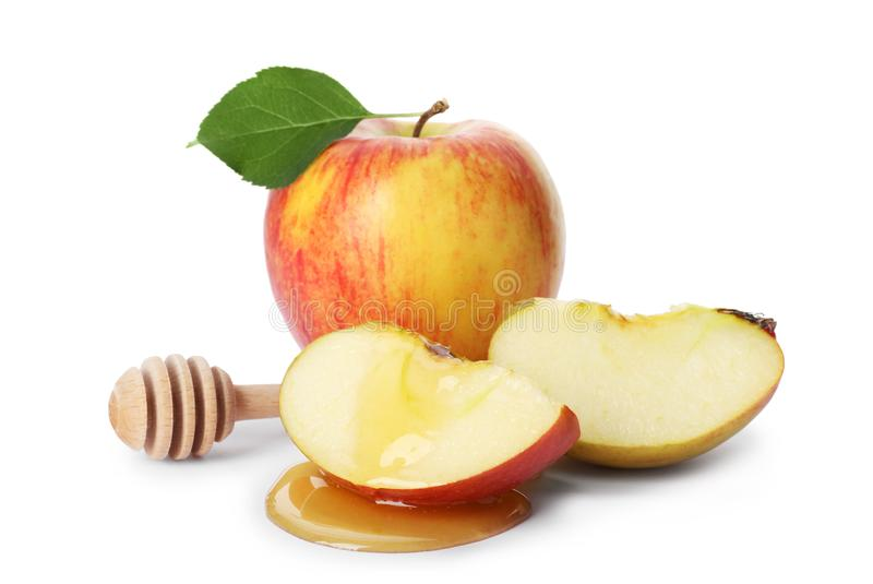 Apples, honey and dipper royalty free stock images