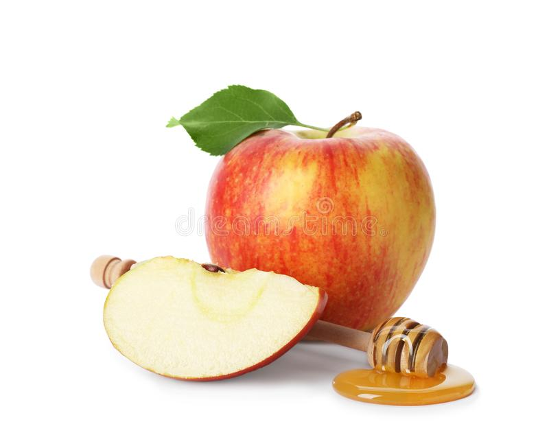 Apples, honey and dipper royalty free stock photography