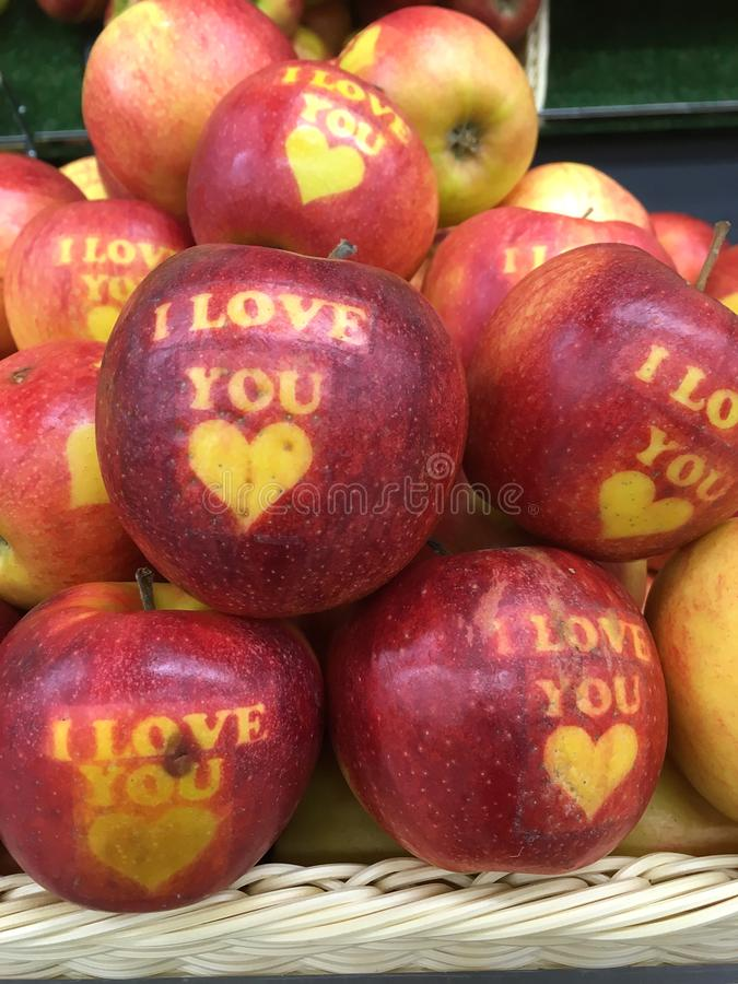 Apples with inscriptions. `I love You`. Red Apple with text I LOVE YOU stock images