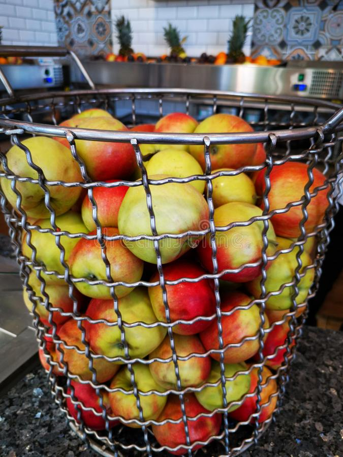 Apples for juice in a wire basket. At bar - fresh fruits stock images