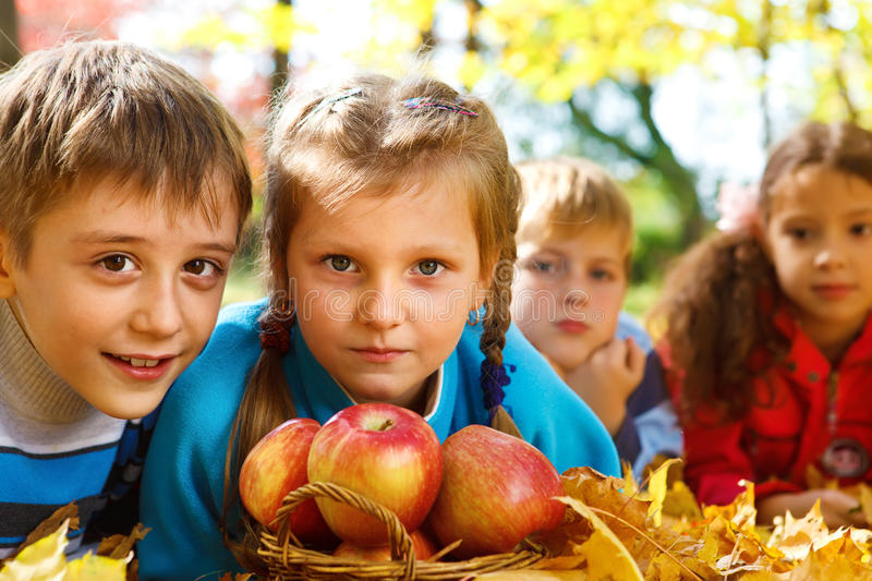 Apples and kids stock image