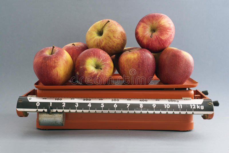 Apples In  Kitchen Scales Royalty Free Stock Photo