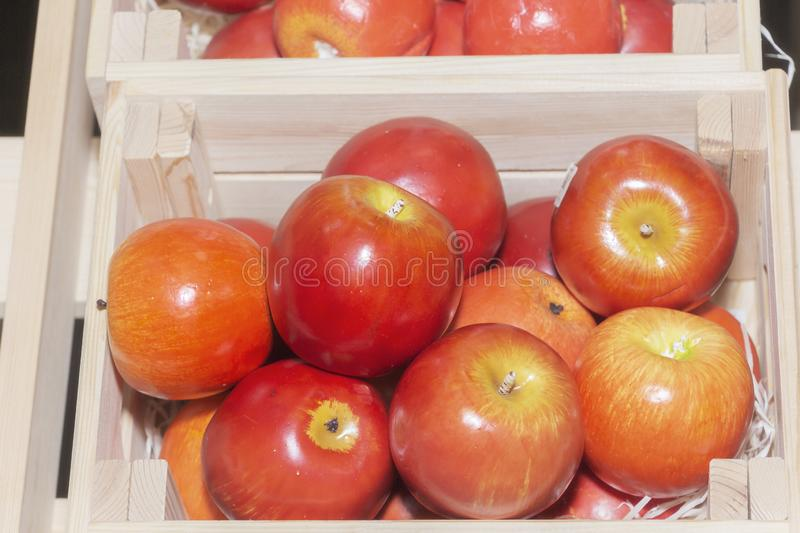 Apples are made of plastic, the concept of development of ecological vegetable growing. Urbanization.  royalty free stock photo