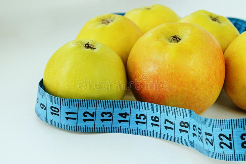Apples and measuring tape stock photo