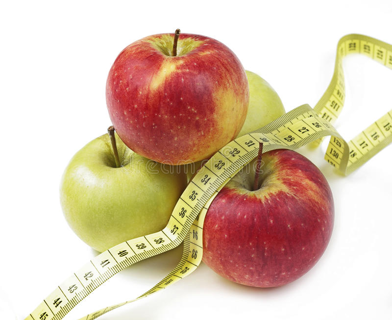 Apples and the measuring tape stock photography