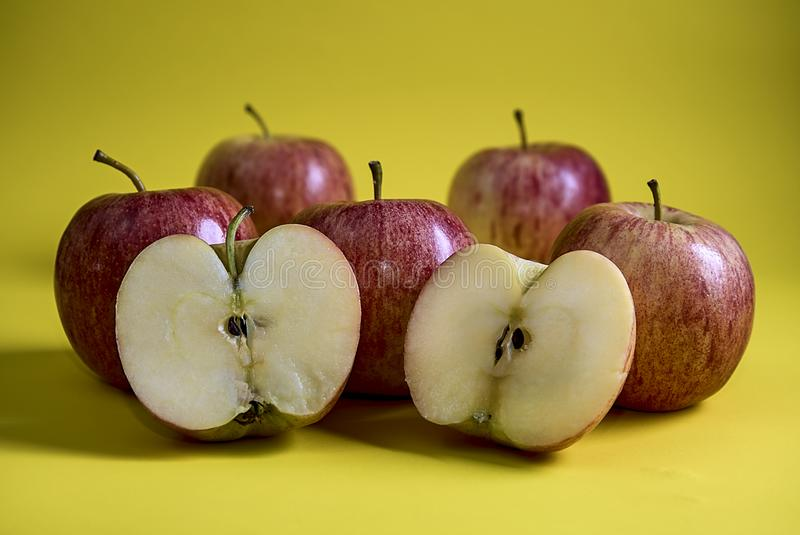 Apples one of them split in half. Picture of Apples one of them split in half royalty free stock photography