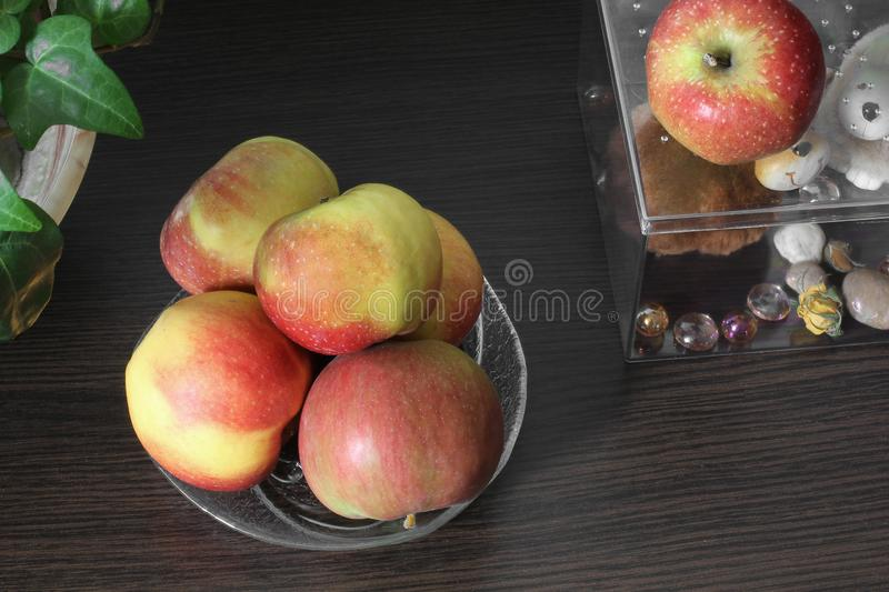 Apples on a plate on wooden background.  royalty free stock images