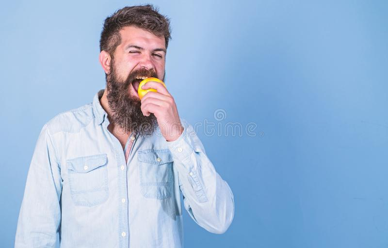 Apples popular fruit in world. Eat healthy. Eat apple can help lower blood sugar levels and protect against diabetes. Man with beard hipster hold apple fruit royalty free stock photography