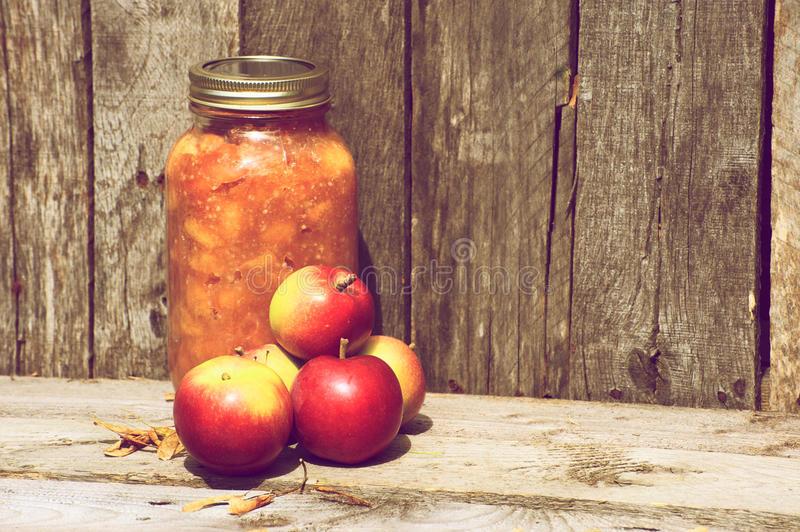 Apples and preserves on wood. royalty free stock images