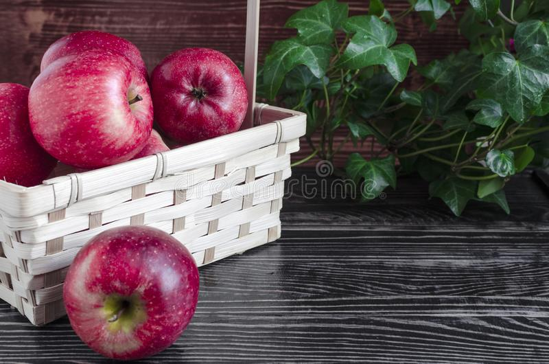 Apples red Apple juice in a transparent glass on a natural background royalty free stock images