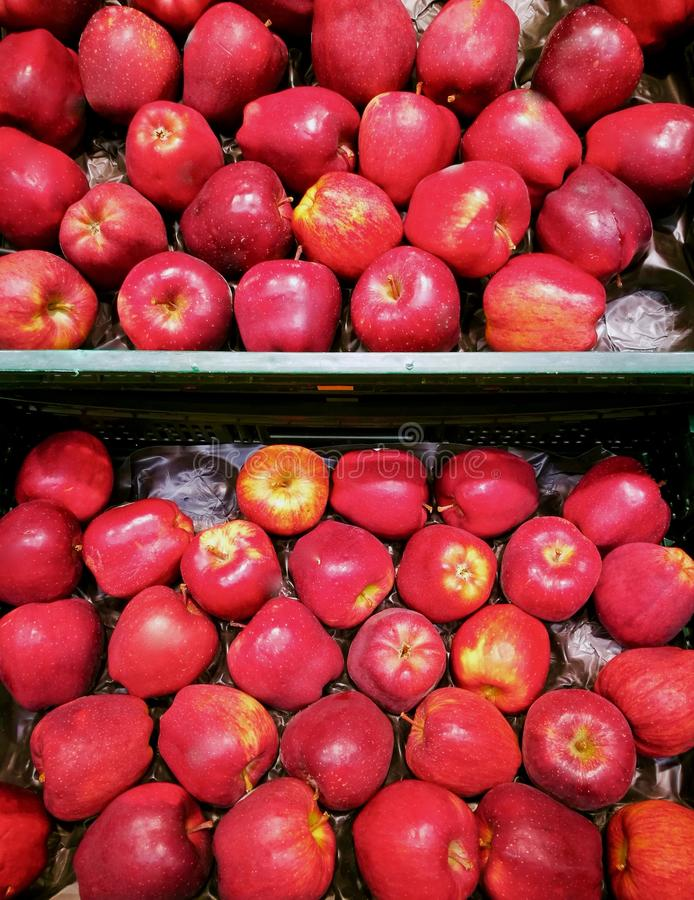 organized fruit crate with red apples in market stock photos
