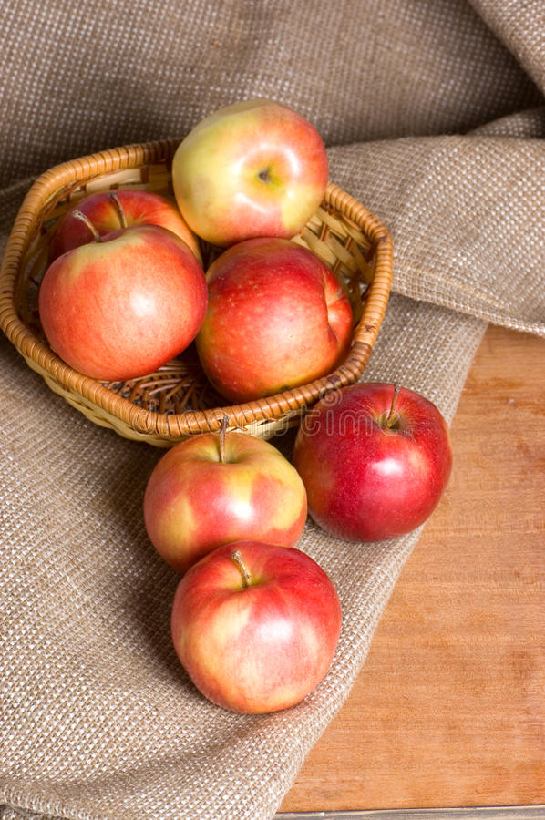 Download Apples On A Sacking On A Wooden Table Stock Photo - Image: 18081108