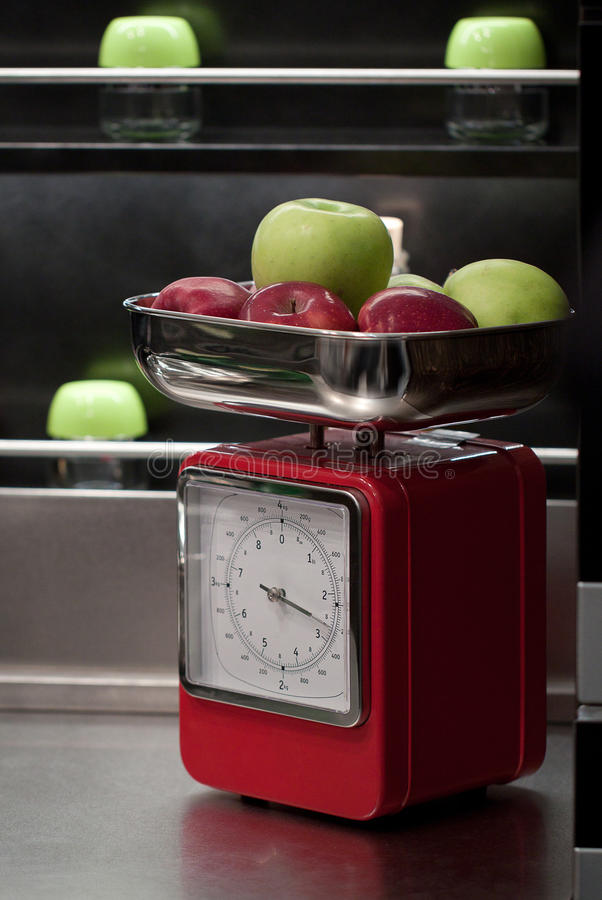 Apples on the scales royalty free stock photos