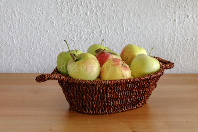Apples in a small basket royalty free stock photography
