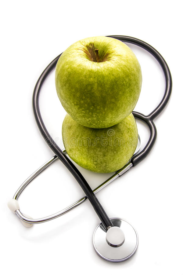 Apples and stethoscope royalty free stock photos