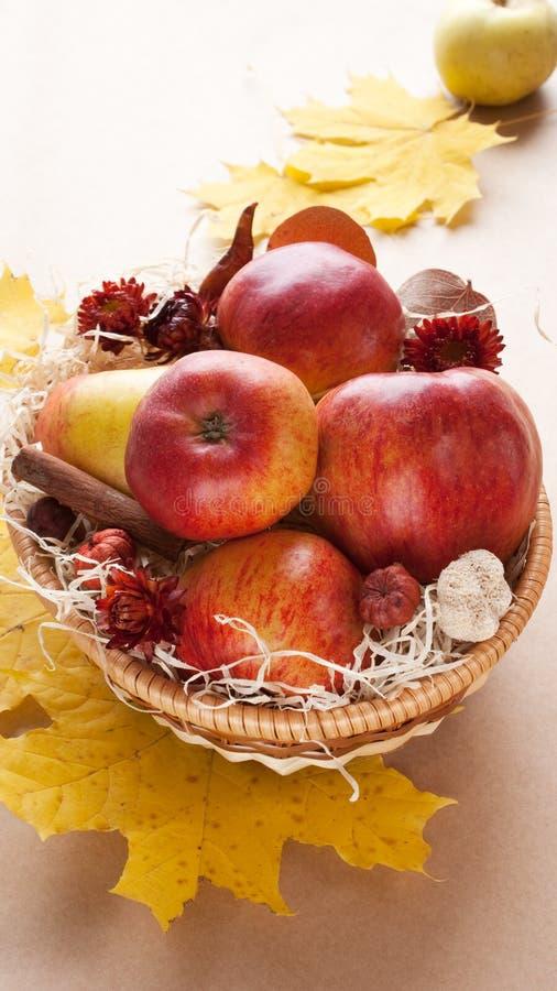 Apples in wicker basket stock photo