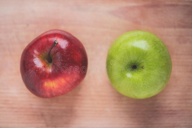 Apples on wooden background royalty free stock photos
