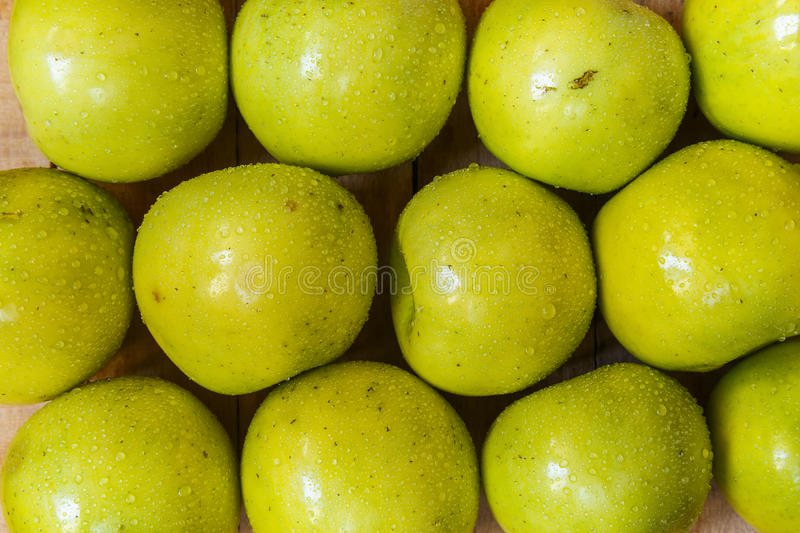 Apples on wooden boards stock images
