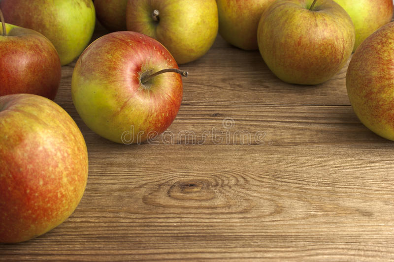 Download Apples on wooden table stock photo. Image of appetising - 26693886