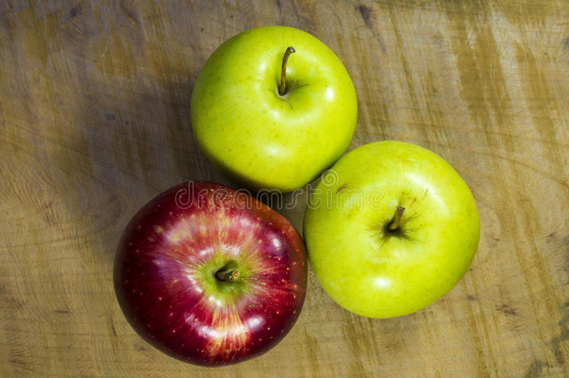 Apples on a wooden table stock photos