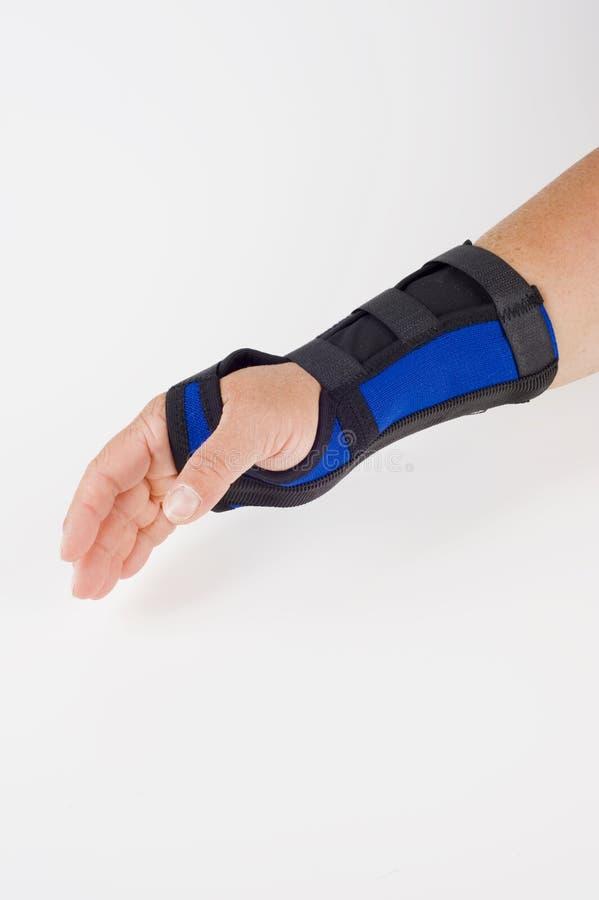 applian förbinda handen sammanfogar den terapeutiska läkarundersökningen royaltyfria bilder