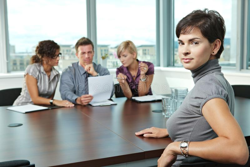 Applicant at job interview. Panel of business people sitting at table in meeting room conducting job interview. Applicant looking at camera royalty free stock photos