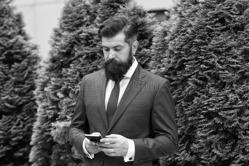 Application for business. Man formal suit use social networks application. Guy surfing internet. Online service and stock photos
