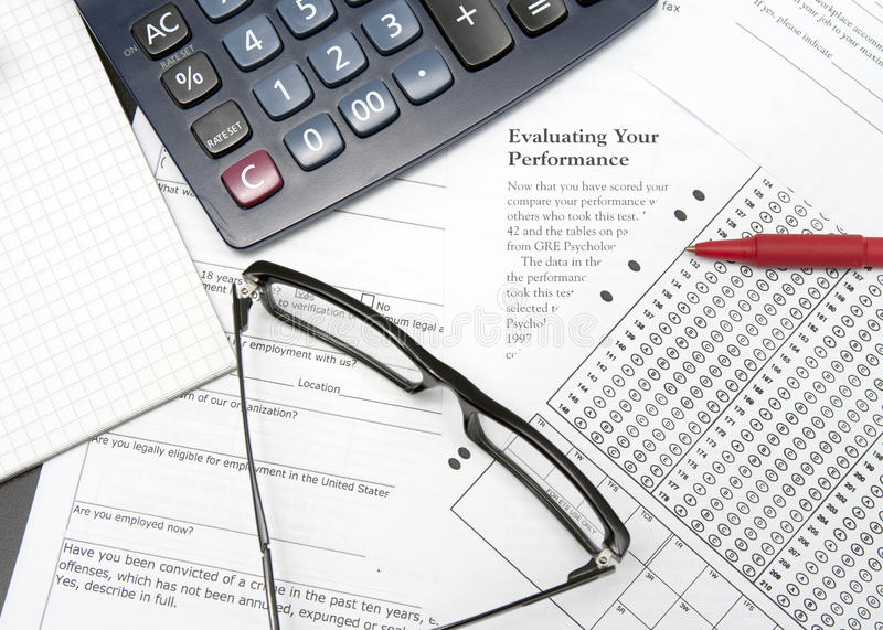 Application calculator. Pen and application form for business experience stock image