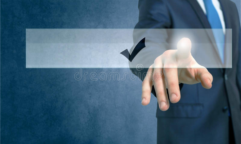 Application icon. Close up of businessman hand touching icon with finger royalty free stock image