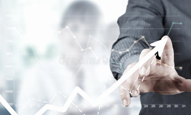 Application icon. Close up of businessman hand touching icon with finger stock photography