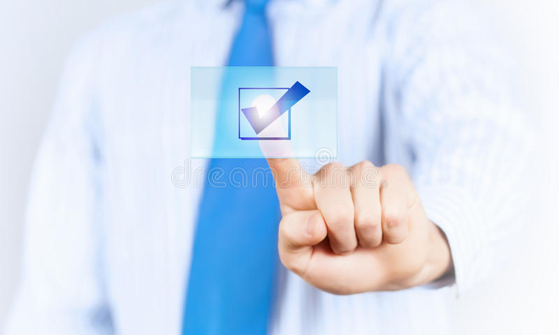 Application icon. Close up of businessman hand touching icon with finger royalty free stock photography