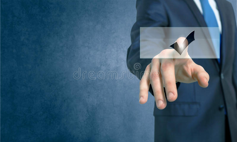 Application icon. Close up of businessman hand touching icon with finger stock photo