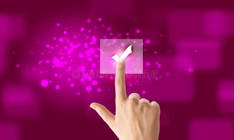 Application icon. Close up of hand touching icon with finger royalty free stock photo