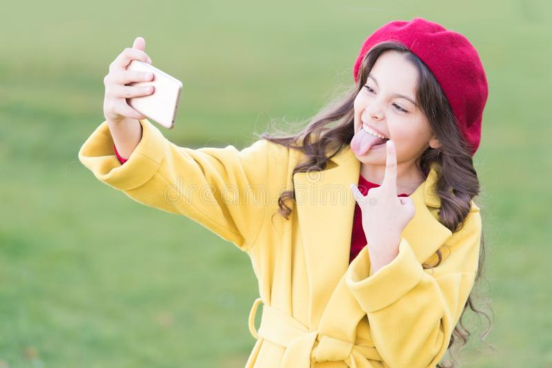 Application for smartphone. Video call concept. Modern communication. Girl hold smartphone taking selfie. Selfie for. Social networks. Streaming online or royalty free stock photo