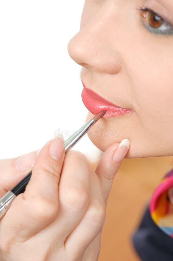 Applicazione del rossetto lucido liquido fotografie stock libere da diritti