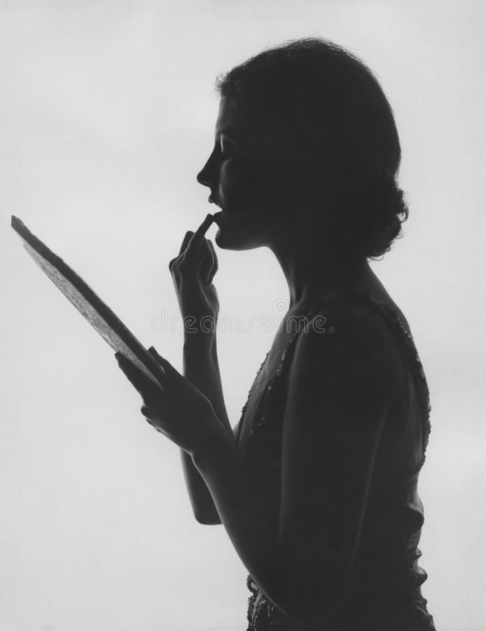 Applicazione del trucco in silouette fotografia stock libera da diritti