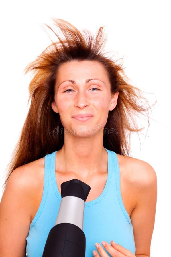 Applicazione femminile dei capelli fotografia stock libera da diritti