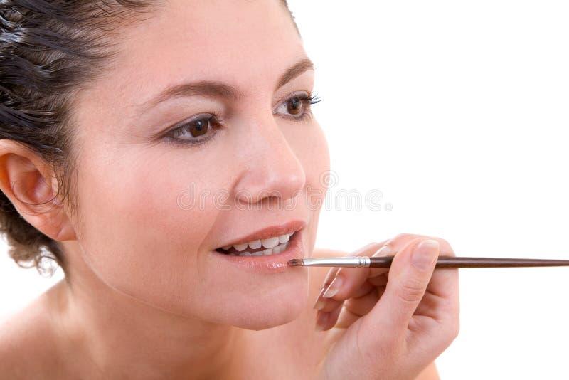 applicera lipgloss royaltyfria foton