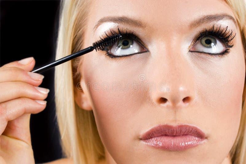 applicera makeup royaltyfri fotografi
