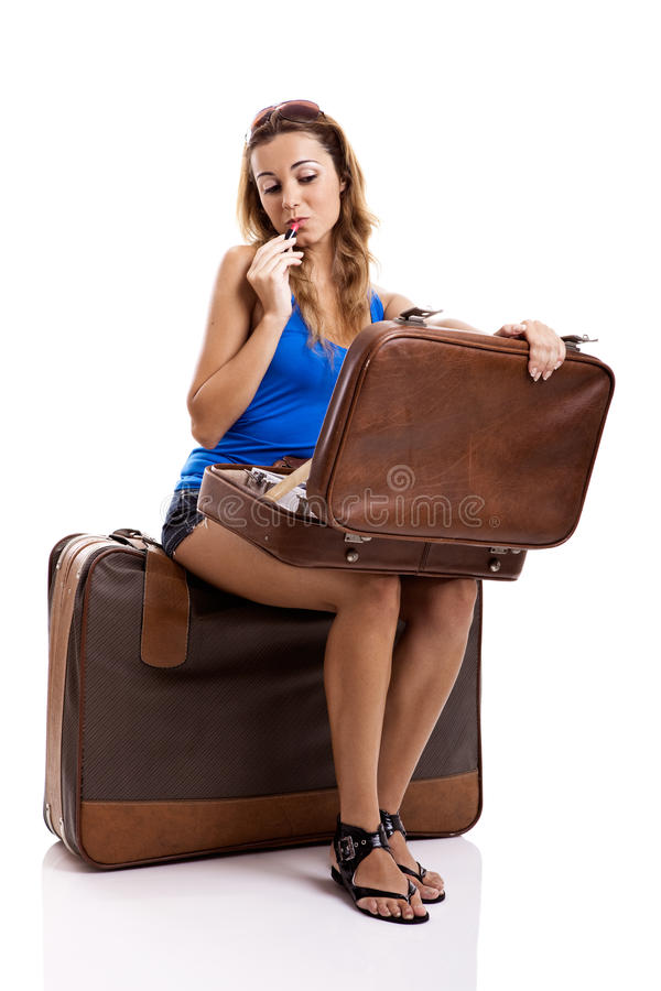 applicera makeuphandelsresandekvinnan arkivfoto