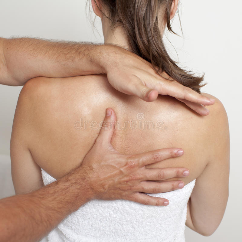 Applied chiropractic care on spine royalty free stock photography