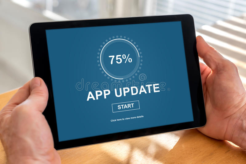 Applikationuppdateringbegrepp på en minnestavla arkivbild