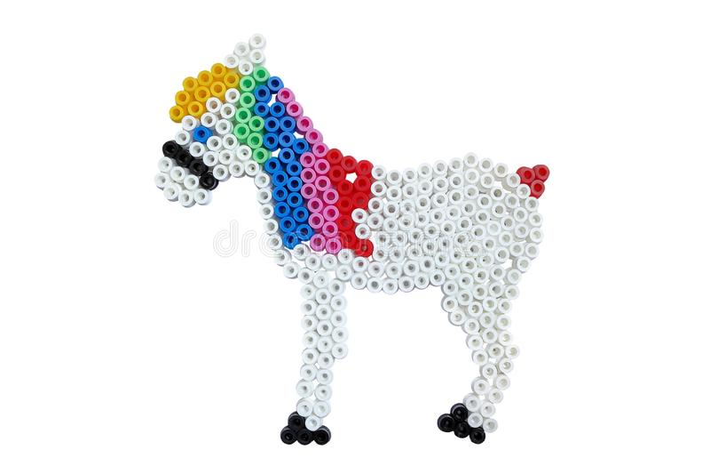 Applique в форме небольшой лошади изолированной на белизне стоковая фотография