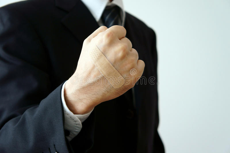 Apply an adhesive plaster fist royalty free stock photo
