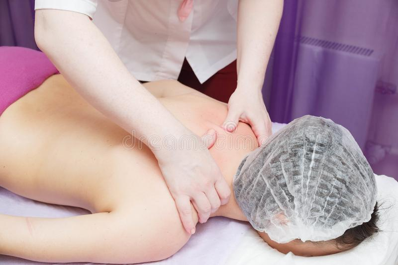 Applying the cream after the procedure of Tibetan massage by fire stock photography