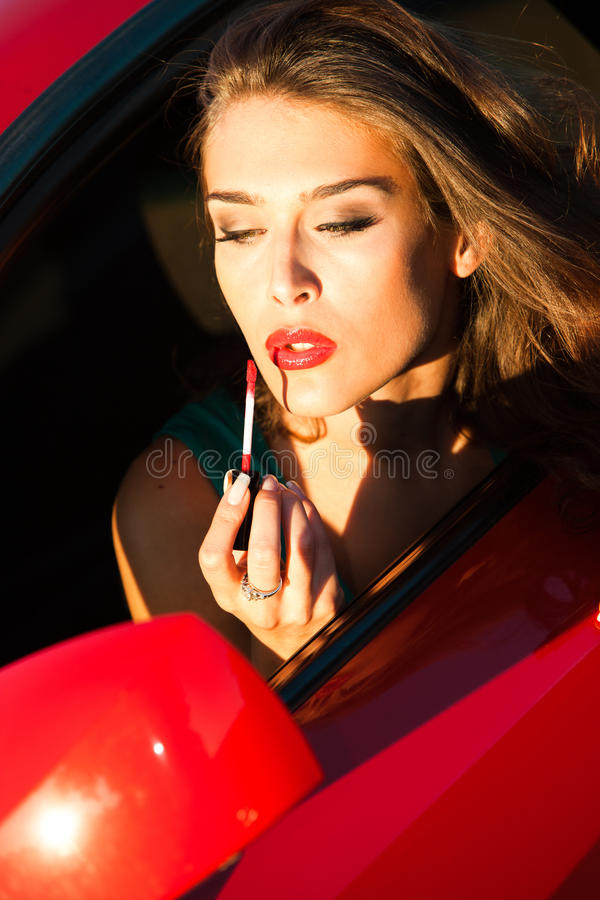 Apply Lipstick In Car Royalty Free Stock Images