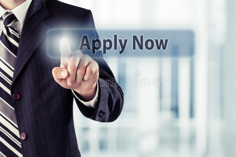 Apply Now. Businessman pressing Apply Now button at his office. Toned photo royalty free stock image