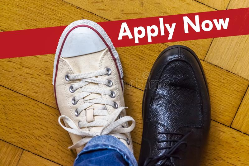 Apply Now Concept in English. An elegant business shoe and a casual shoe with the Phrase Apply Now stock photos