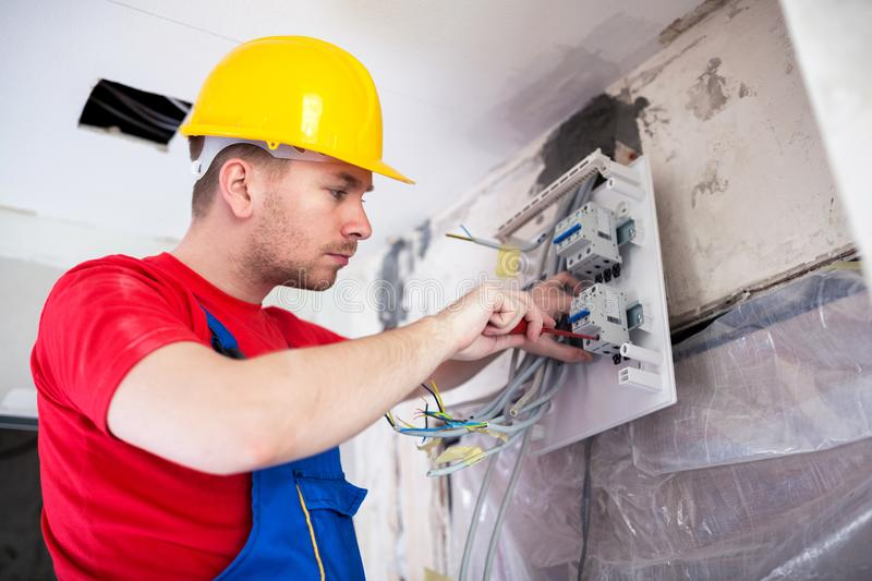 Applying automatic switches on distribution board. With standard screwdriver royalty free stock image