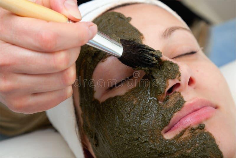 Applying beauty mask stock images